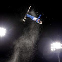 Kiley McKinnon, of the United States, warms up prior to the women's freestyle aerial final at Phoenix Snow Park at the 2018 Winter Olympics in Pyeongchang, South Korea, Friday, Feb. 16, 2018.