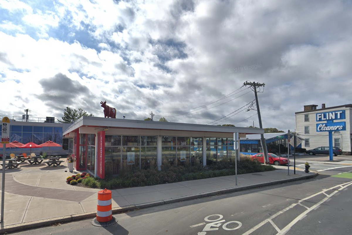 A bakery of mostly glass and steel, and backdropped by a blue sky, sits alone on Western Avenue in Allston's Barry's Corner.