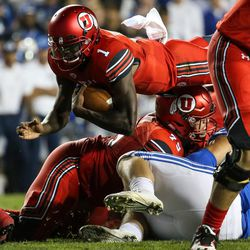 Utah Utes quarterback Tyler Huntley (1) dives on a run against the Brigham Young Cougars at LaVell Edwards Stadium in Provo on Saturday, Sept. 9, 2017.