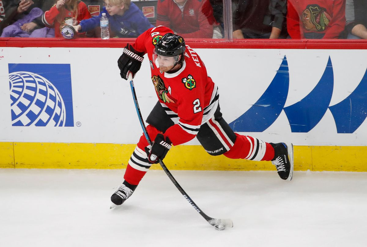 Mar 18, 2019; Chicago, IL, USA; Chicago Blackhawks defenseman Duncan Keith (2) attempts a shot against the Vancouver Canucks during the first period at United Center. Mandatory Credit: Kamil Krzaczynski
