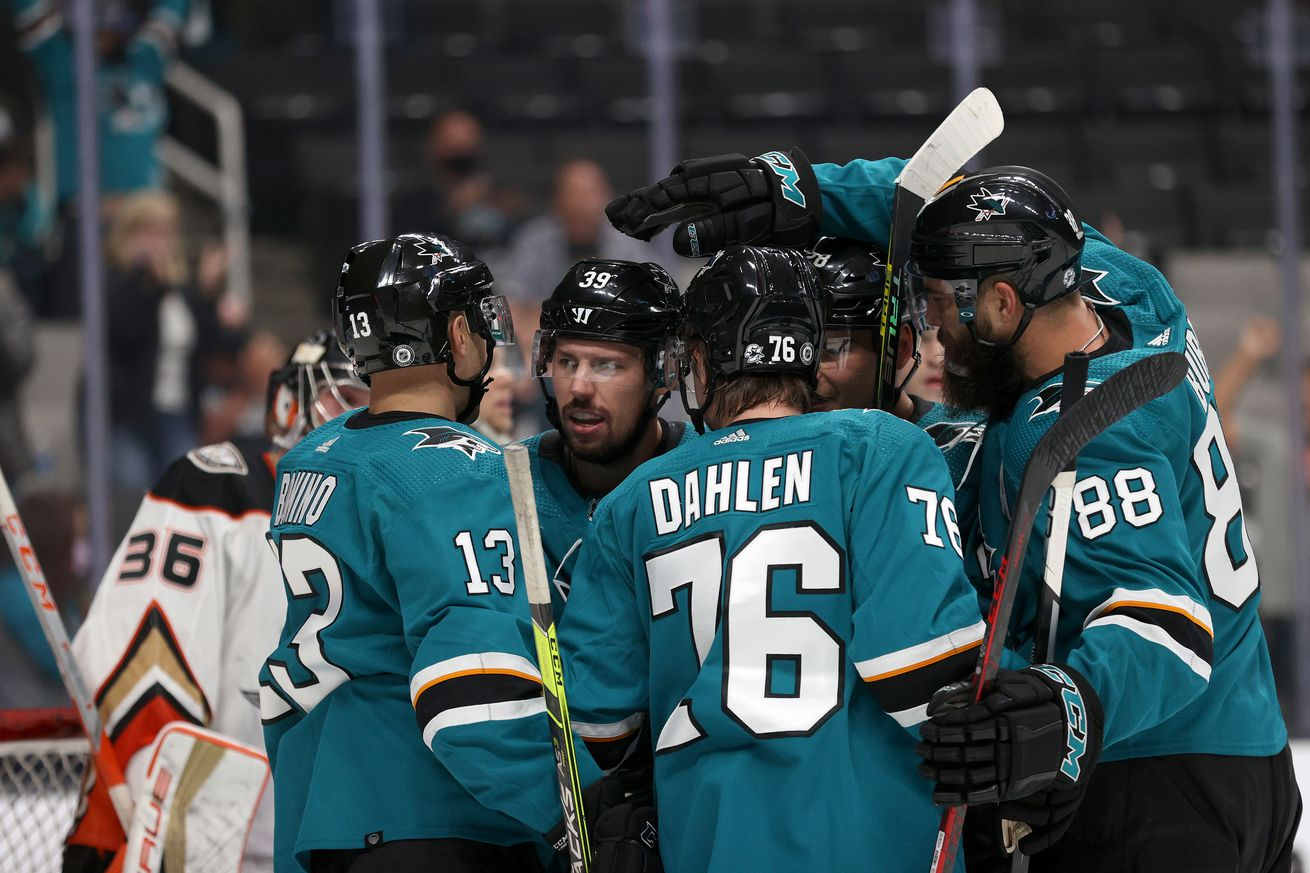 Logan Couture #39 of the San Jose Sharks is congratulated by teammates after he scored against the Anaheim Ducks in the second period is at SAP Center on October 04, 2021 in San Jose, California.