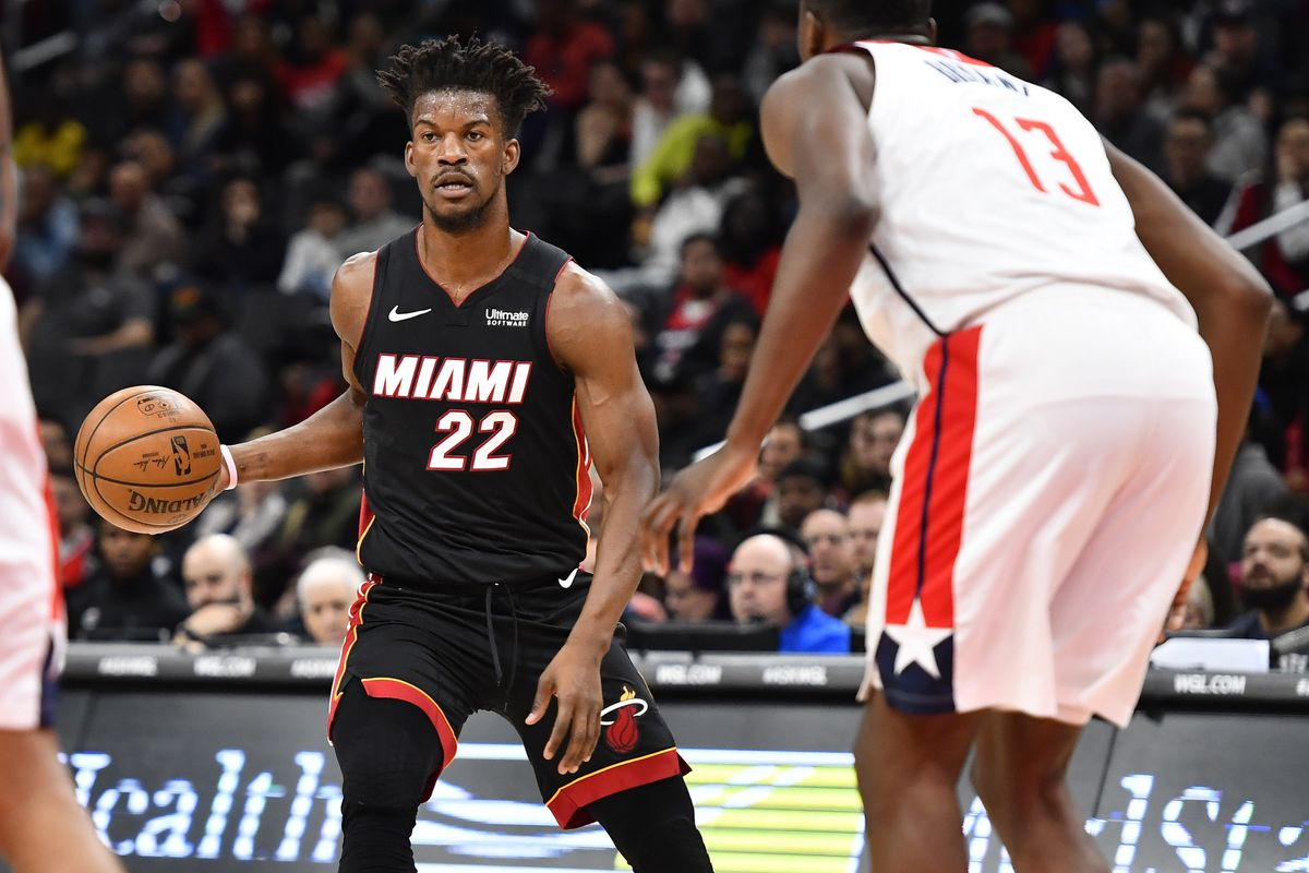 Miami Heat forward Jimmy Butler dribbles the ball as Washington Wizards center Thomas Bryant defends during the first quarter at Capital One Arena.