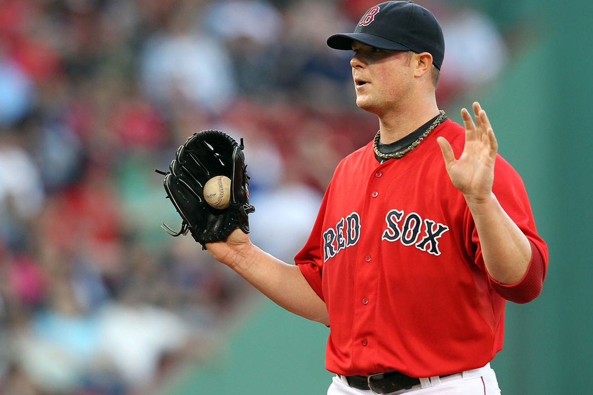BOSTON, MA - MAY 25:  Jon Lester #31 of the Boston Red Sox gestures before the start of a game against the Tampa Bay Rays in the first inning at Fenway Park May 25, 2012  in Boston, Massachusetts. (Photo by Jim Rogash/Getty Images)