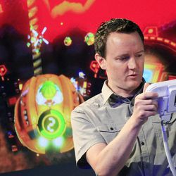 Nintendo's Bill Trinen demonstrates the Wii U GamePad, Thursday, Sept. 13, 2012 in New York. The gaming console will start at $300 and go on sale in the U.S. on Nov. 18, in time for the holidays, the company said Thursday.