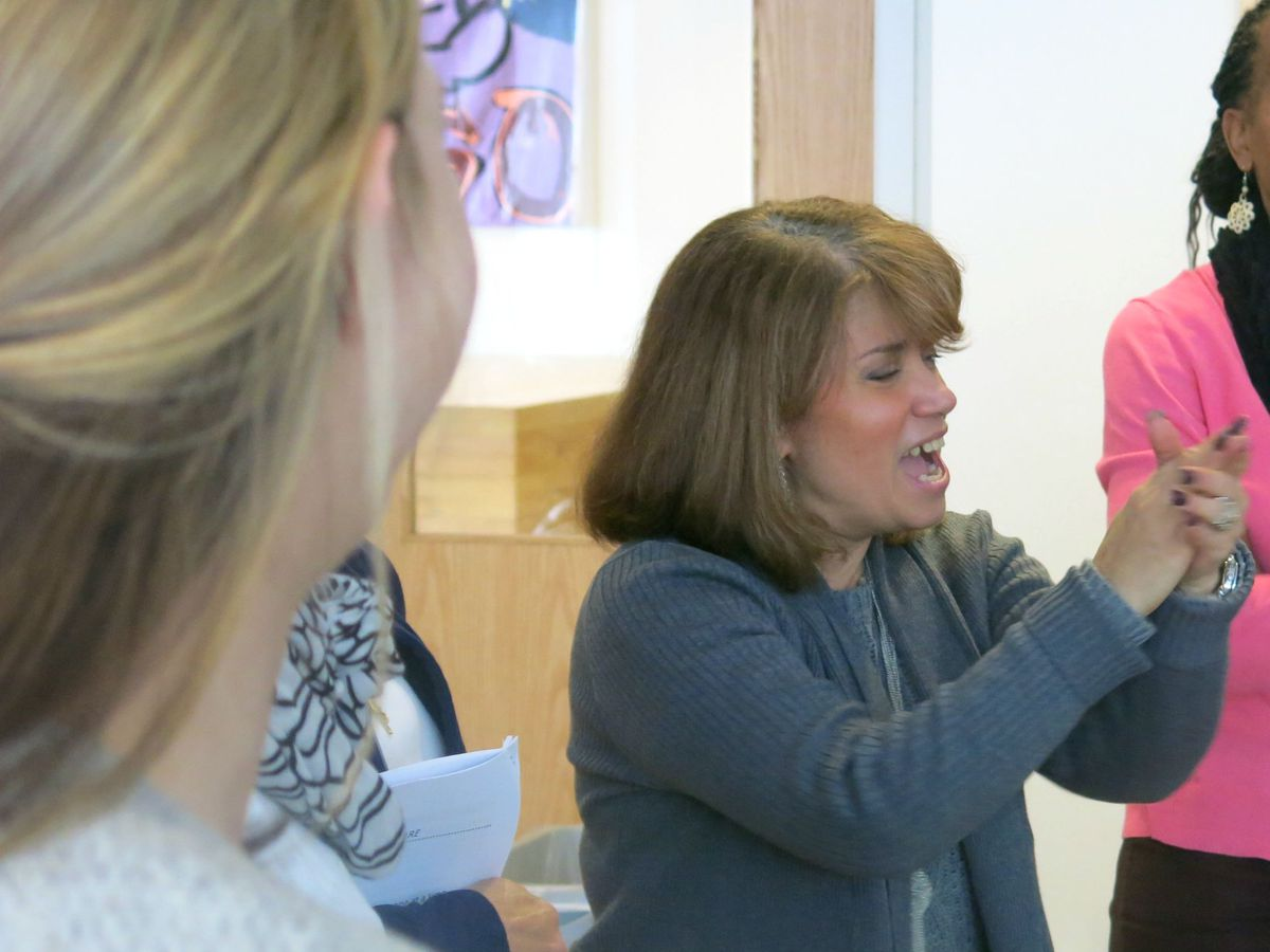 Superintendent Rodriguez-Rosario led District 9 teachers in a cheer during a mentor-training session in March.