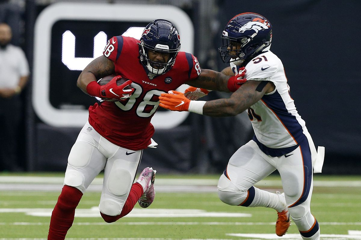 Jordan Akins #88 of the Houston Texans fends off Todd Davis #51 of the Denver Broncos as he runs with the ball after a catch during the second half at NRG Stadium on December 08, 2019 in Houston, Texas. Denver defeated Houston 28-24.