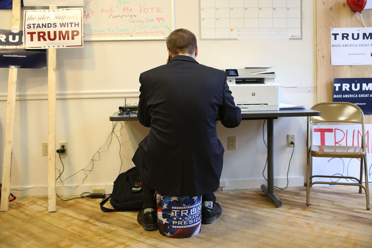 Blake West calls voters asking them to vote for Republican presidential candidate Donald Trump while working at the Newmarket Trump campaign headquarters on February 8, 2016, in Newmarket, New Hampshire.