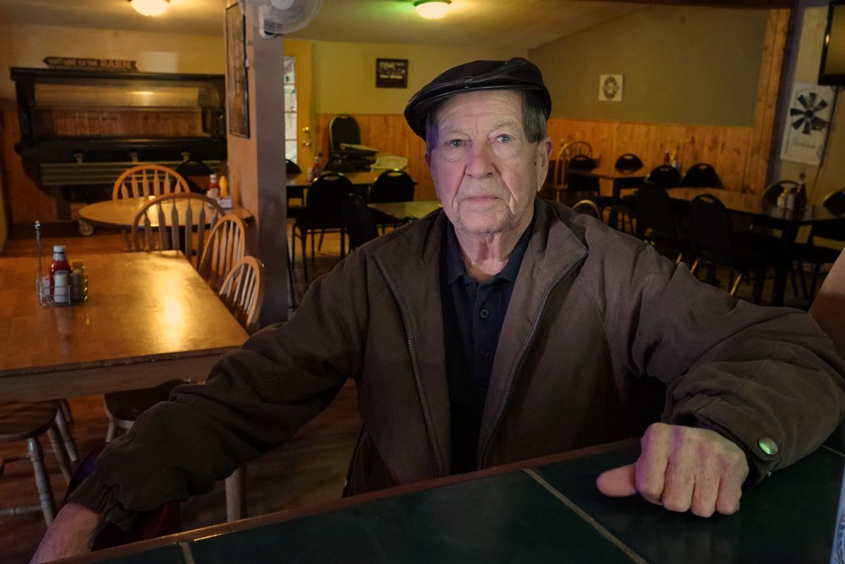 Ernest Garber, sitting at the end of the bar at The Farmhouse in Delevan, is conflicted about marijuana legalization. | Brian Rich/Sun-Times