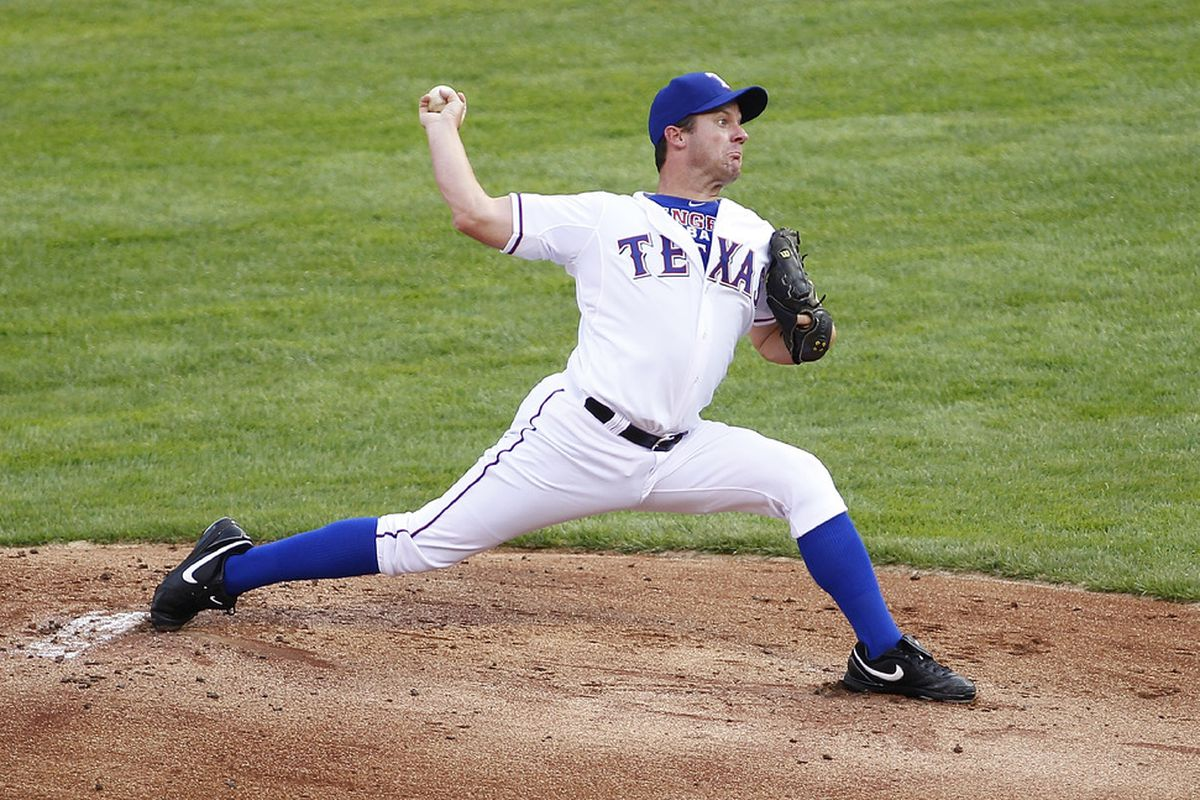 ARLINGTON, TX - JUNE 22: Roy Oswalt #44 of the Texas Rangers delivers a pitch against the Colorado Rockies at Rangers Ballpark in Arlington on June 22, 2012 in Arlington, Texas. (Photo by Rick Yeatts/Getty Images)
