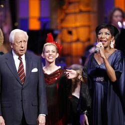Author David McCullough and singer Natalie Cole join in singing Friday at the annual Christmas concert at the Conference Center.