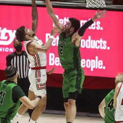 UVU Wolverines forward Evan Cole (2) blocks the shot of Utah Utes forward Timmy Allen (1) during a game at the Huntsman Center in Salt Lake City on Tuesday, Dec. 15, 2020.
