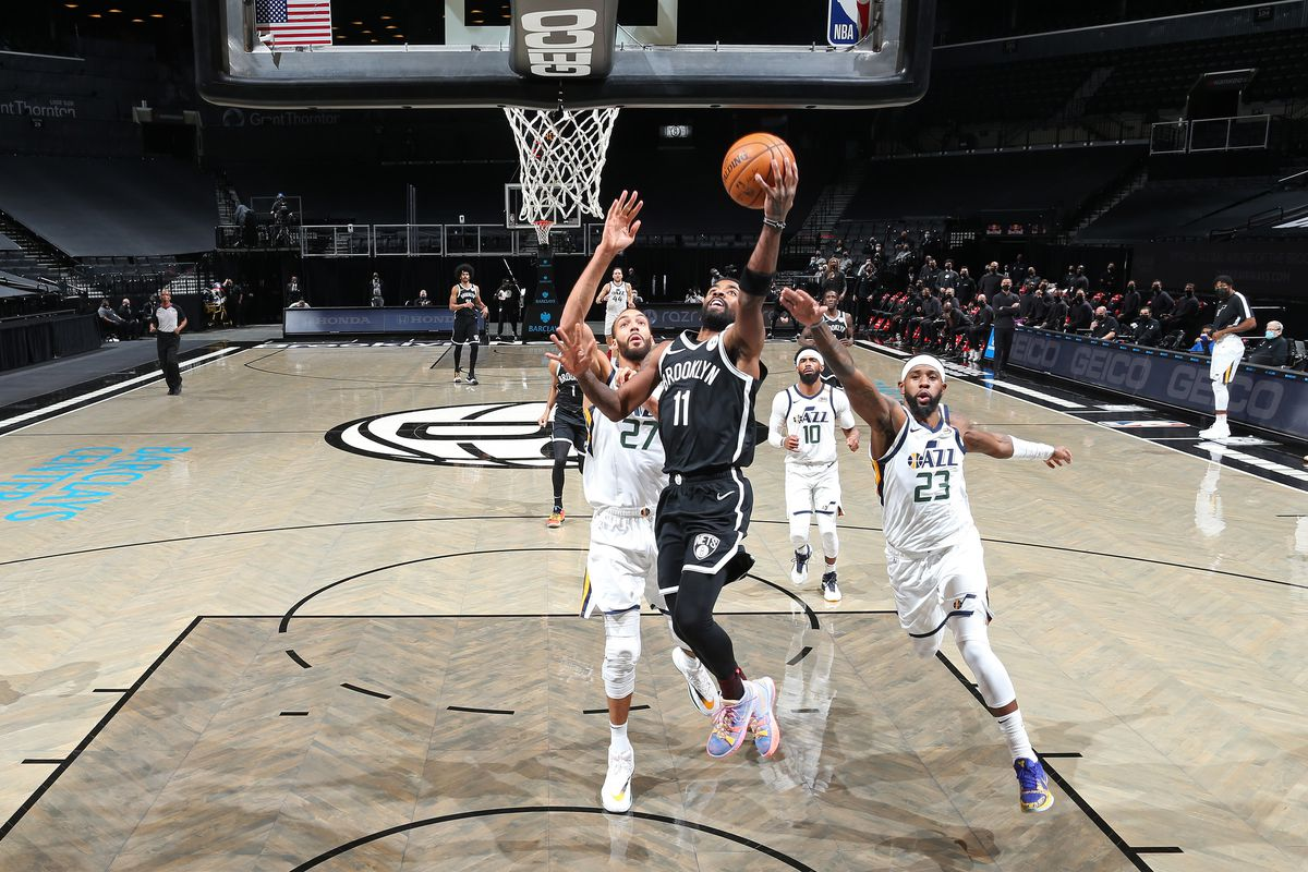 Kyrie Irving of the Brooklyn Nets drives to the basket against the Utah Jazz on January 5, 2021 at Barclays Center in Brooklyn, New York.