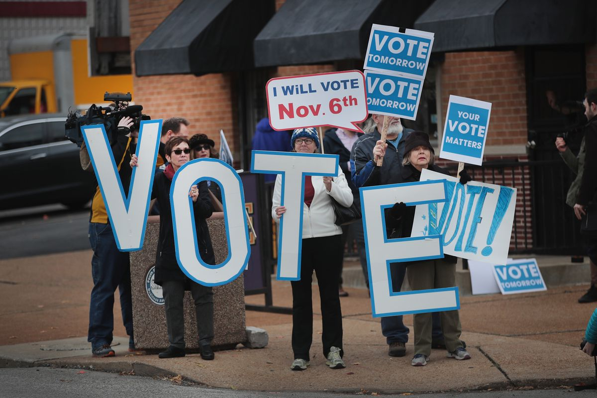 Supporters of Senator Claire McCaskill (D-MO) with signs that say vote wait for the senator to arrive for a campaign stop at The Royale bar on November 5, 2018 in St. Louis, Missouri.  (Photo by Scott Olson/Getty Images)