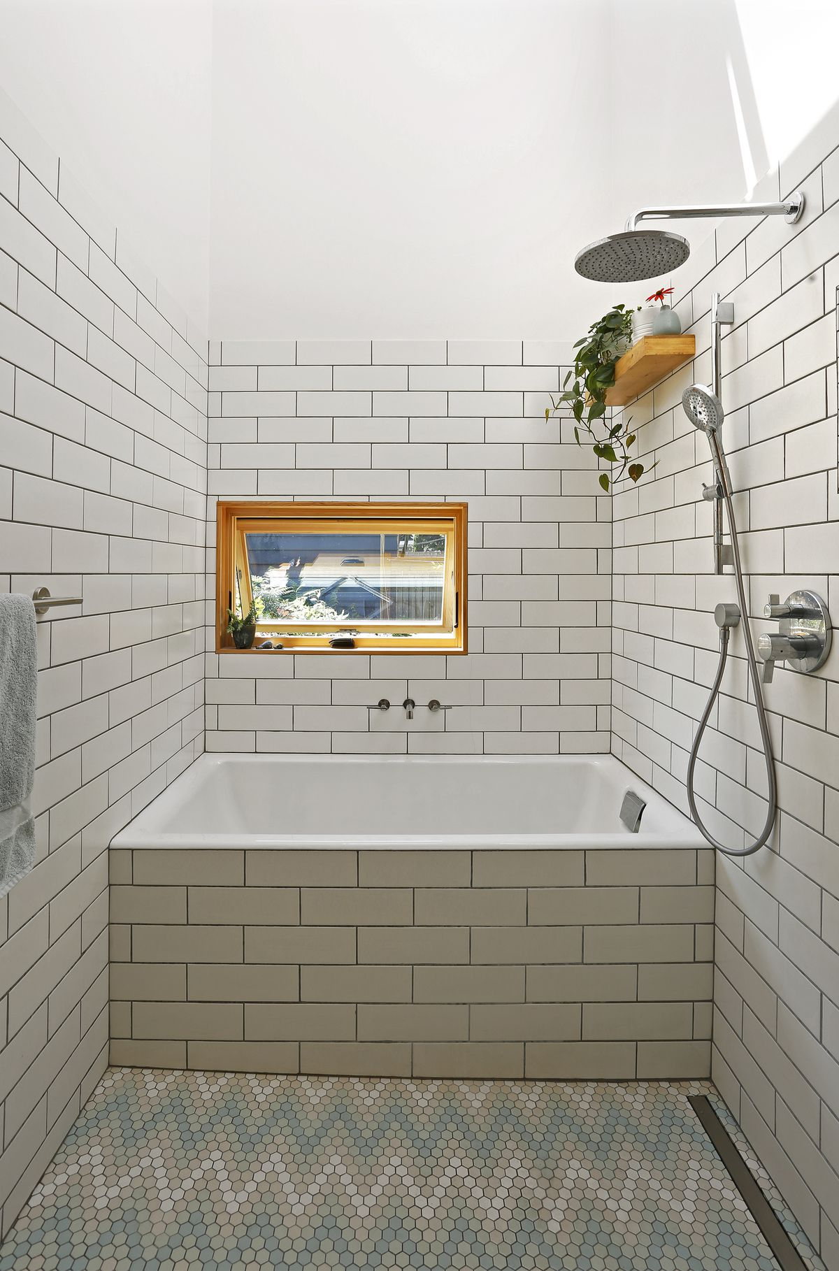 Bathroom with white subway tile walls.