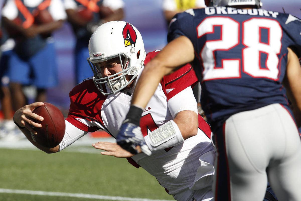 1Arizona Cardinals quarterback Kevin Kolb (4) scores a touchdown in front of New England Patriots safety Steve Gregory (28) in the third quarter of an NFL football game on Sunday, Sept. 16, 2012 in Foxborough, Mass. The Cardinals won 20-18.