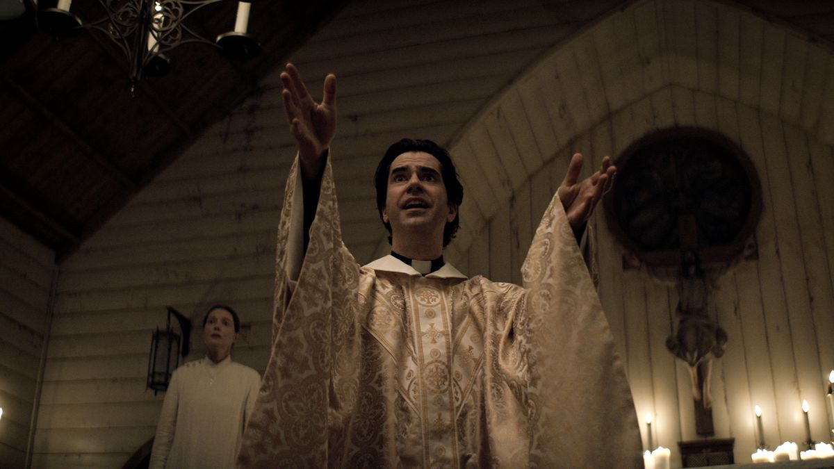 Hamish Linklater holds forth from the pulpit in church in Netflix's Midnight Mass