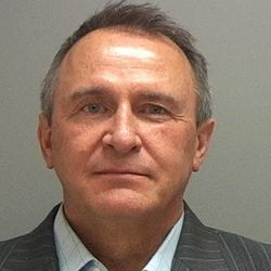 Former Utah Attorneys General Mark Shurtleff and John Swallow, not pictured, were charged Tuesday July 15, 2015 and arrested for allegations ranging from accepting bribes to destroying evidence. Both were arrested at their Sandy homes by members of the FBI and the Utah Department of Public Safety and the they arrived at the Salt Lake County Jail shortly after 8 a.m.