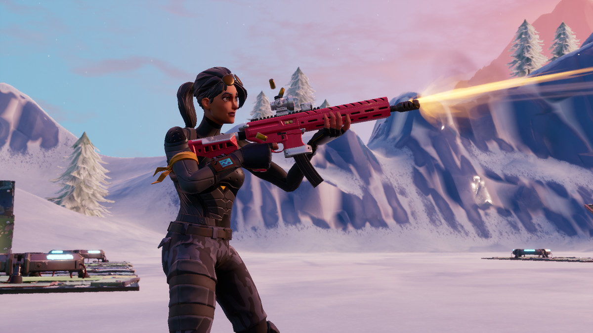 female Fornite character firing the Tactical Assault Rifle in the snow