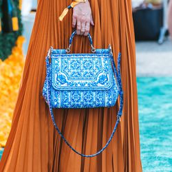 And this bag is everything. We're just obsessed with her whole look.