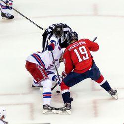 Moore and Backstrom Faceoff