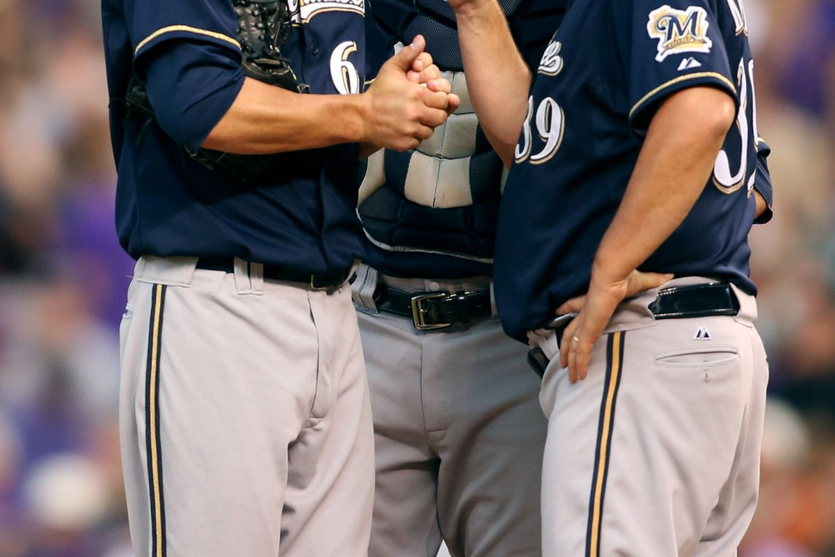 August 13, 2012; Denver, CO, USA; Milwaukee Brewers pitching coach Rick Kranitz (39) talks with starting pitcher Mike Fiers (right)  during the third inning against the Colorado Rockies at Coors Field.  Mandatory Credit: Chris Humphreys-US PRESSWIRE