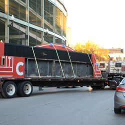 4:29 p.m. Another view of the flatbed truck pulling away -