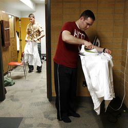 In the foreground, Elder Anthony Franklin irons his shirt as Elder Samuel Miller packs up in the background to leave the MTC.  Provo Missionary Training Center of The Church of Jesus Christ of Latter-day Saints in Provo, Utah Tuesday, Feb. 15, 2011.
