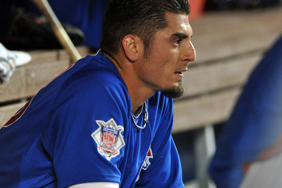 Miami, FL, USA; Chicago Cubs starting pitcher Matt Garza sits in the dugout during the fifth inning against the Miami Marlins at Marlins Park. Credit: Steve Mitchell-US PRESSWIRE