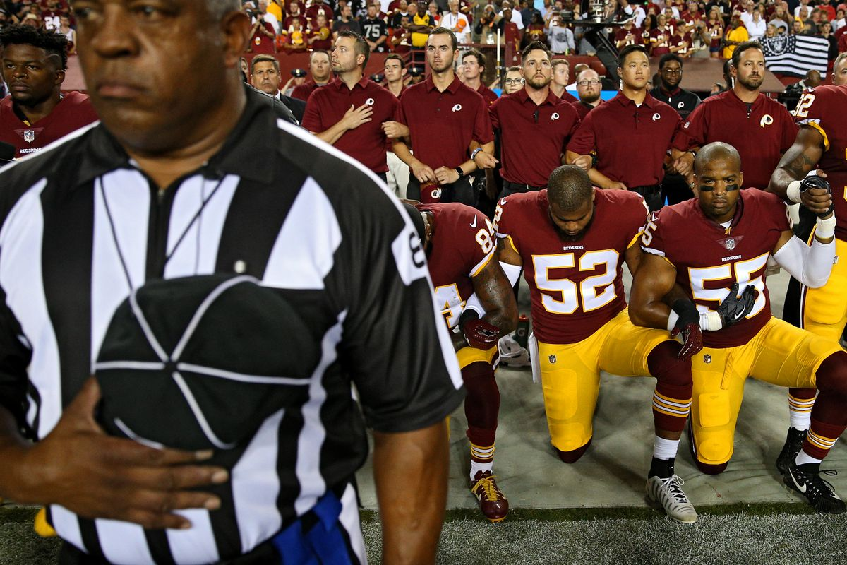 Ryan Anderson locks arms with Washington Redskins teammates during the national anthem