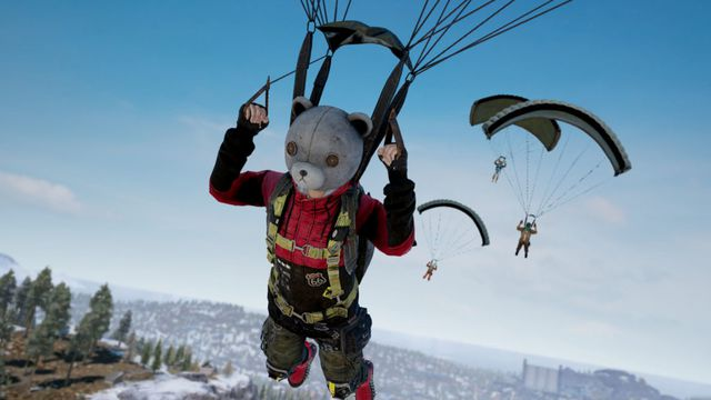 A player in a bear costume parachutes onto an island in PUBG season 7