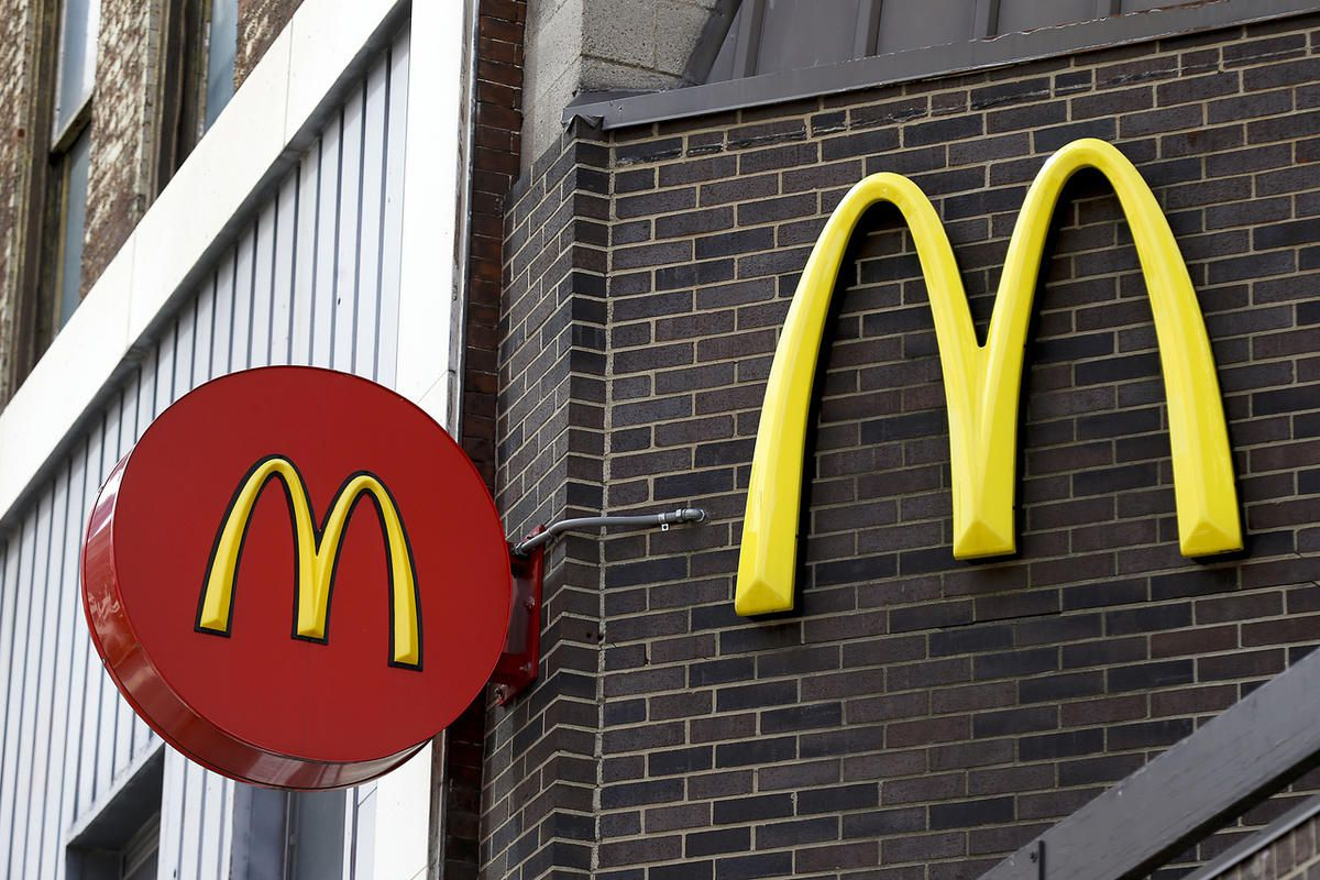 In this Monday, April 24, 2017, photo, corporate signage hangs at a McDonald's restaurant in downtown Pittsburgh. McDonald's Corp. reports earnings on Tuesday, April 25. (AP Photo/Keith Srakocic)