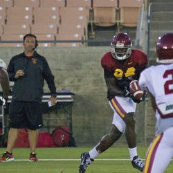 Randall Telfer catches a perfectly placed pass behind the defense as Sarkisian looks on.