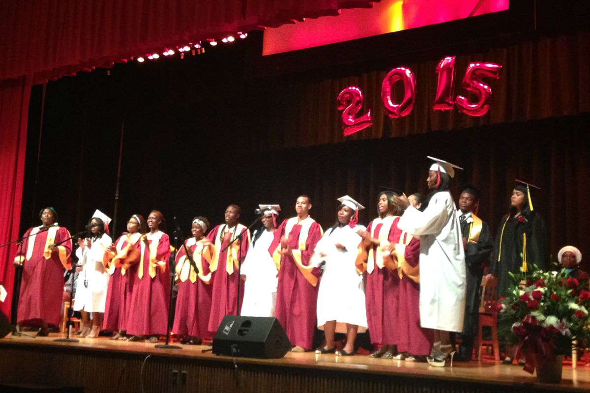 A joint Medgar Evers-Boys and Girls choir performed at a graduation.