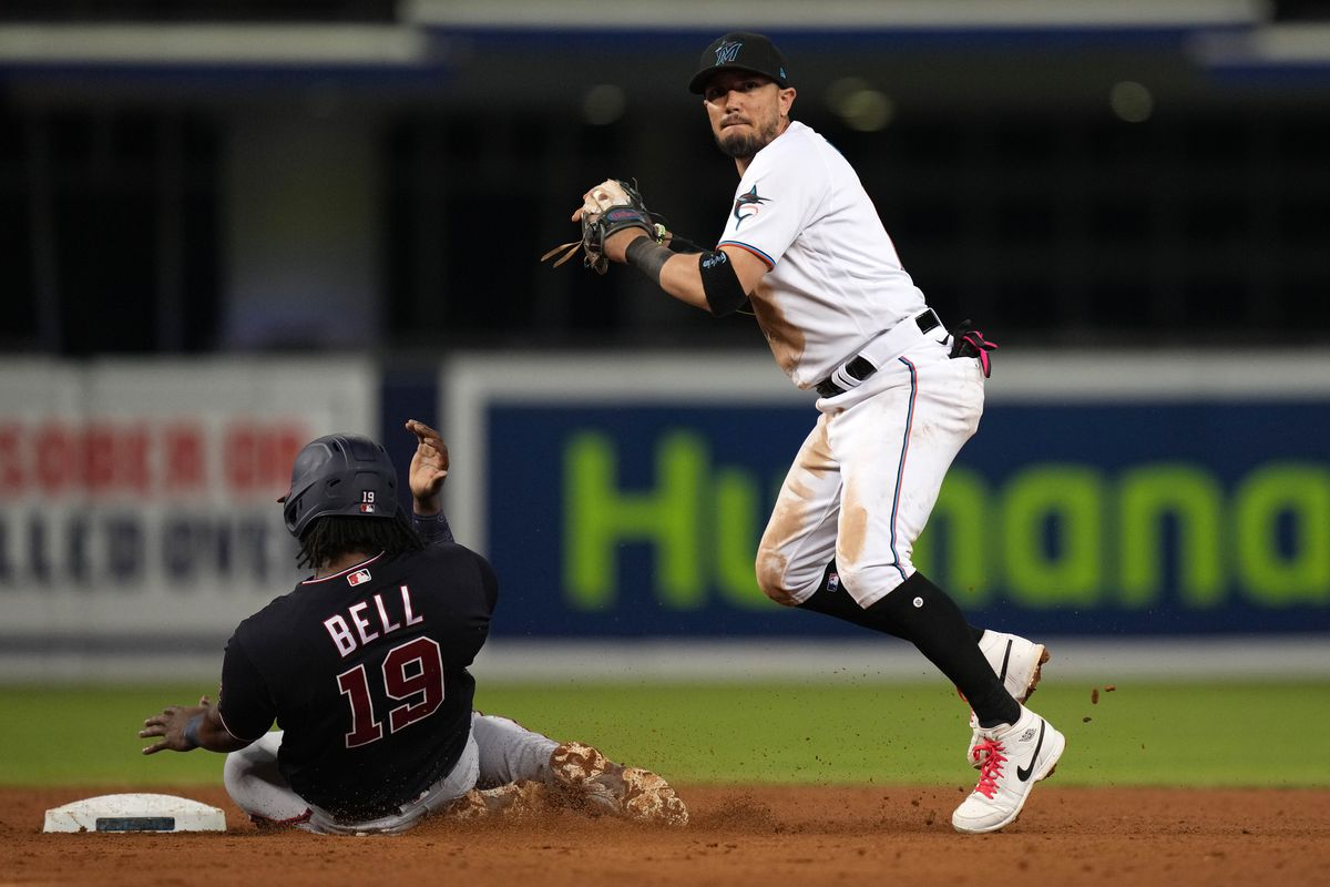 Miami Marlins shortstop Miguel Rojas (19) gets the force out of Washington Nationals first baseman Josh Bell (19) in the 9th inning at loanDepot park.