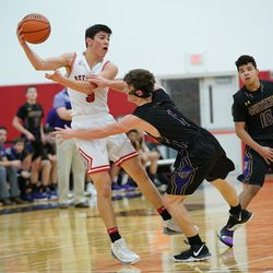 Rolling Meadows' Jace (1) O'Hara grabs Deerfield's Danny Golub (5) as he passes the ball, Wednesday 02-06-19. Worsom Robinson/For the Sun-Times.