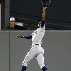 Tampa Bay Rays center fielder B.J. Upton leaps to catch a fly ball by Baltimore Orioles' Adam Jones in the first inning of a baseball game in Baltimore, Wednesday, Sept. 12, 2012.