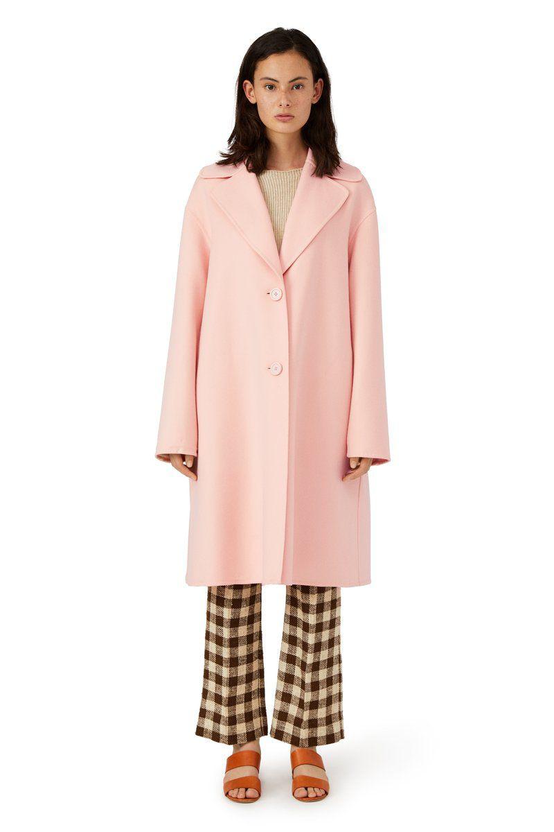 A model in a pink wool coat