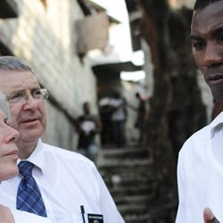 Berthony Theodor, director of LDS Church Welfare in Haiti, listens as two LDS Humanitarian missionaries discuss an immunization outreach program in the slums of Port Au Prince.