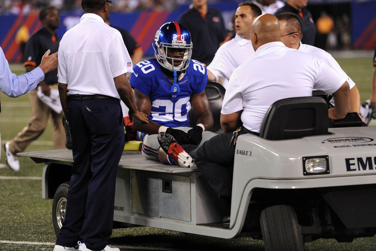 Aug 24, 2012; East Rutherford, NJ, USA;  New York Giants cornerback Prince Amukamara (20) is carted off the field during the first half against the Chicago Bears at Metlife Stadium. Joe Camporeale-US PRESSWIRE