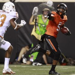 Oklahoma State wide receiver Josh Stewart (5) runs past Texas cornerback Carrington Byndom (23) for a touchdown in the first quarter of an NCAA college football game in Stillwater, Okla., Saturday, Sept. 29, 2012.