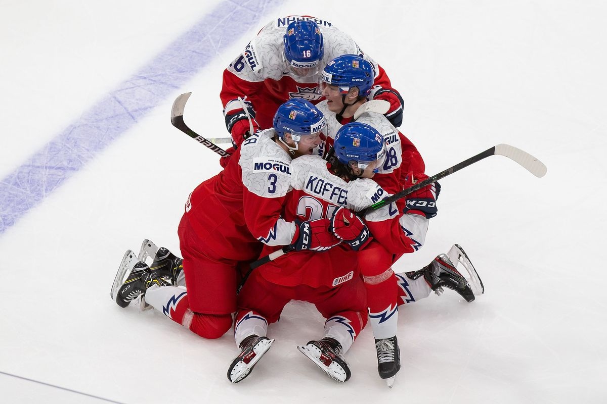 Filip Koffer #27 of the Czech Republic celebrates with Karel Klikorka #3, Michael Krutil #28 and Adam Najman #16 after scoring a goal against Russia during the 2021 IIHF World Junior Championship at Rogers Place on December 27, 2020 in Edmonton, Canada.