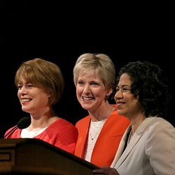 The LDS Church's Relief Society general presidency (left to right) Sister Sharon Eubank, first counselor; Sister Jean B. Bingham, president; and Sister Reyna I. Aburto, second counselor, speak at BYU Women's Conference in the Marriott Center ain Provo on Friday, May 5, 2017.