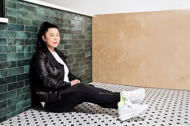 Mei Lin at Daybird with green tiling background.