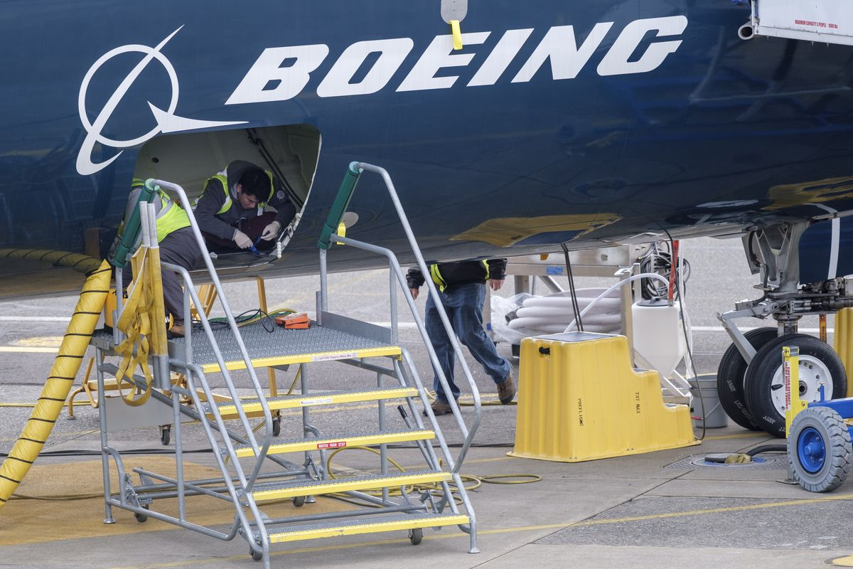 Employees work on a Boeing 727 Max 9 plane in Renton, Washington, in March 2019.