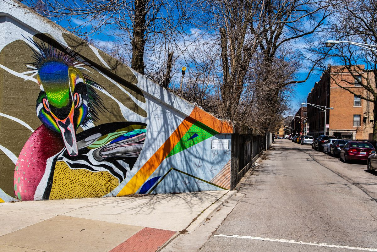 """The brightly colored image of a duck on a viaduct in Rogers Park. This mural, part of the """"Miles of Murals"""" project, was done in conjunction with the National Audubon Society."""