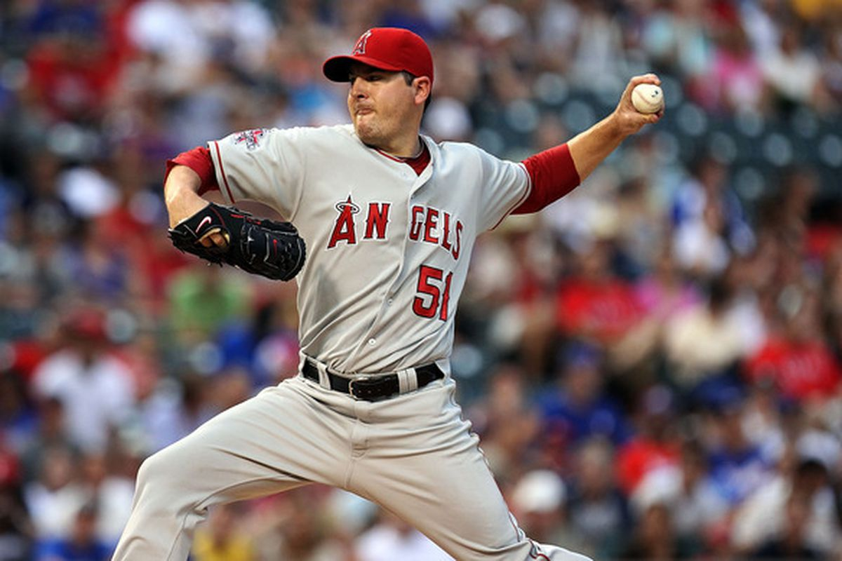 ARLINGTON TX - JULY 23:  Pitcher Joe Saunders #51 of the Los Angeles Angels of Anaheim throws against the Texas Rangers on July 23 2010 at Rangers Ballpark in Arlington Texas.  (Photo by Ronald Martinez/Getty Images)