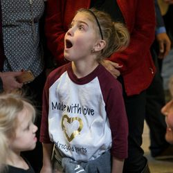 Makenzie Madsen, 11, a heart transplant recipient, reacts as she talks to Jan Scoffield, right, who was talking about friends of hers who have two children who've had heart transplants and a son who is waiting for one, at a ceremony hosted by Intermountain Donor Services in Salt Lake City on Wednesday, Dec. 21, 2016.