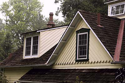 A dormer that has a flat top sloping downwards like a shed rooftop.