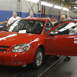 In this Aug. 2008 file photo, auto workers at the  Lordstown Assembly Plant work on the Chevy Cobalts in Lordstown, Ohio.