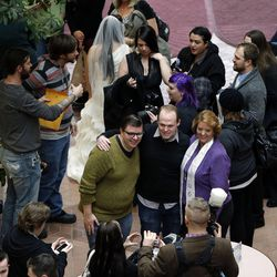 Couples are married outside the Salt Lake County clerk's office, Monday, Dec. 23, 2013. U.S. District Judge Robert Shelby denied a motion by the state of Utah to halt same-sex marriages pending an appeal.